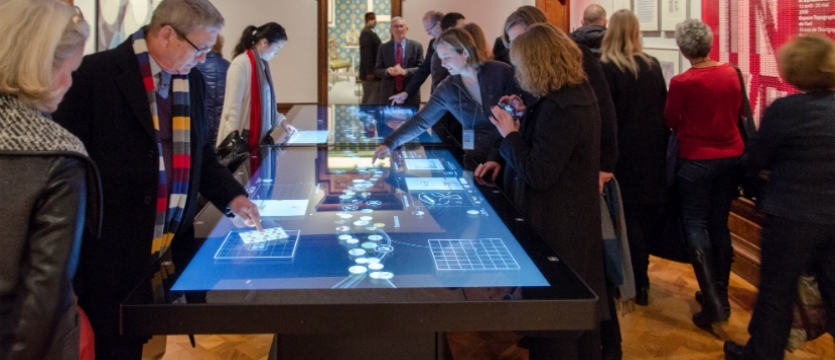 Local Projects designed interactive table surfaces to work in tandem with The Pen. Photo Credit: Ed Blake